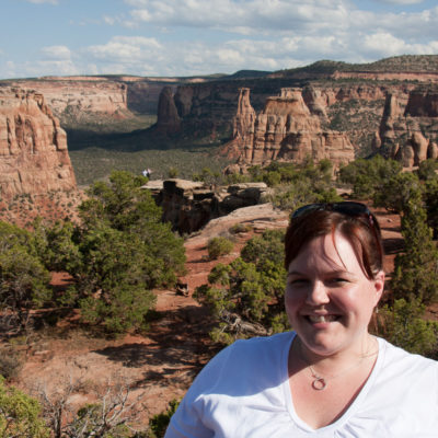 Kate in front of Monument Canyon