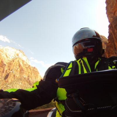 Cruising Zion.  I love the reflections of the mountains off the helmet.