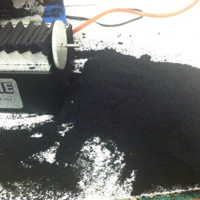 mounds of black foam dust