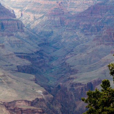 The Colorado River carving through the Canyon.  The picture is a bit blown up due to the haze.