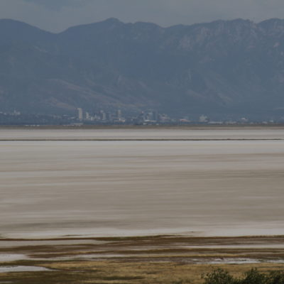 Salt Lake City from Antelope Island.   if you look close there is an Antelope standing near the shore at the bottom.
