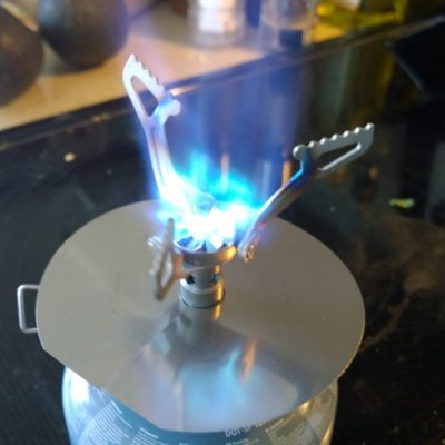 At full burn, not as symetrical as the stock Jetboil burner, but every bit as effective.
